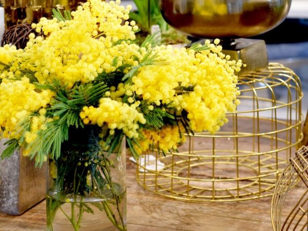 Yellow bouquet on rustic table